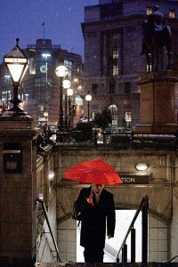 Red umbrella in the rain. The Bank, London. By Damien Demolder