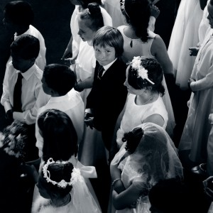 Boy looking up at first communion